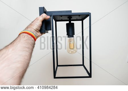 Pov Male Hand Looking At Vintage Filament Light Bulb On Box Lantern Wall Light Vintage Style With Ed