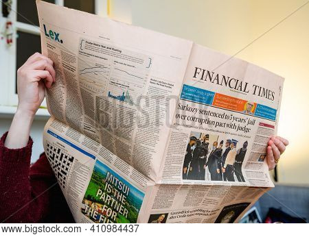 Paris, France - Mar 2, 2021: Business Woman Reading Financial Times Newspaper With Headline Former F