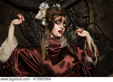 Young female with bright makeup, zombie style in steampunk scenery. Party, Halloween, Holiday.