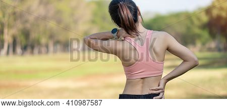 Young Fitness Woman Holding Her Sports Injury Neck, Muscle Painful During Training. Asian Runner Fem