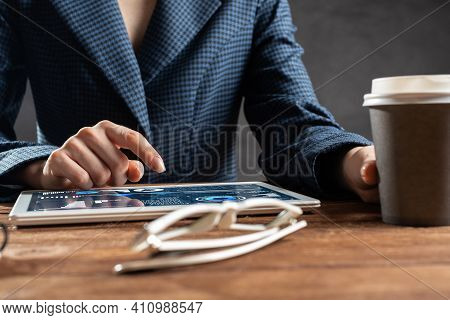 Businesswoman Using Tablet Computer At Wooden Desk. Close Up Woman Hand Pointing On Touchscreen. Bus