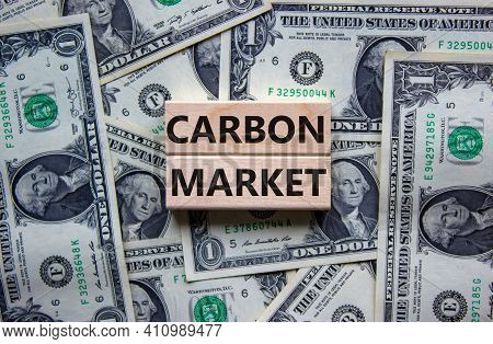 Carbon Market Symbol. Concept Words 'carbon Market' On Wooden Blocks On A Beautiful Background From