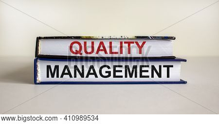 Quality Management Symbol. Concept Words 'quality Management' On Books On A Beautiful White Table, W
