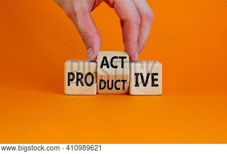 Proactive And Productive Symbol. Businessman Turns Cubes And Changes The Word 'productive' To 'proac