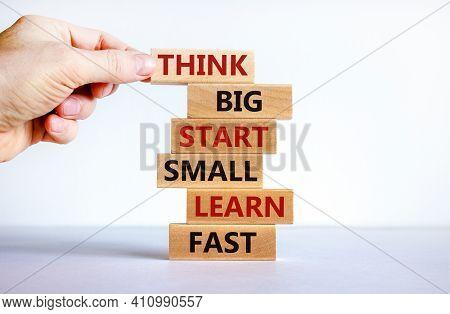 Think Big Start Small Symbol. Words 'think Big Start Small Learn Fast' On Wooden Blocks On A Beautif