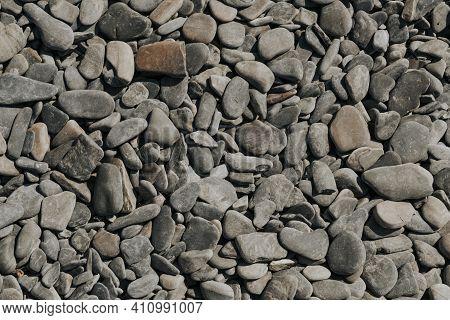 Small Stone Texture. Sea Gray Pebbles Background. Sea Stones.
