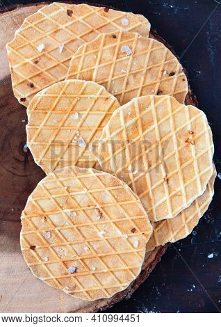 Round Salty Waffles, Crunchy Snacks On Wooden Background.