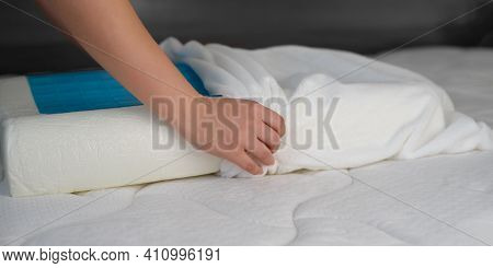 Women's Hands Put A Cover On The Orthopedic Pillow With Cooling Gel. Protecting The Foam Pillow From