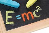 The formula E=mc2 on a blackboard at school poster