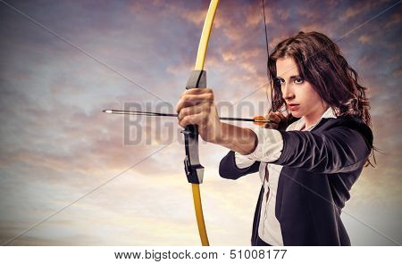beautiful career woman pulls arrow with a bow