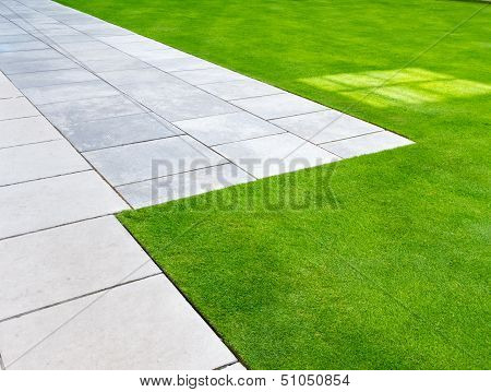 Edge of lawn and path as abstract or background poster