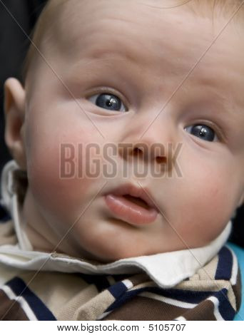 Surprised Baby With Eyes Wide Open