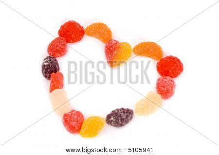 Heart made of sweet candies colorful jelly candies with different fruits taste. Candies shaped in different ways. poster