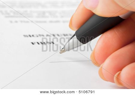 Hand With Pen And Contract