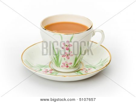 Tea Served In A Hand Painted Cup And Saucer