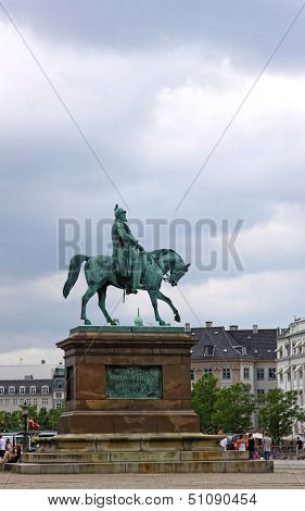 Bronze statue of Frederik VII of Denmark (1808 - 1863) sitting on his horse in front of Christiansborg Palace in Copenhagen, Denmark poster