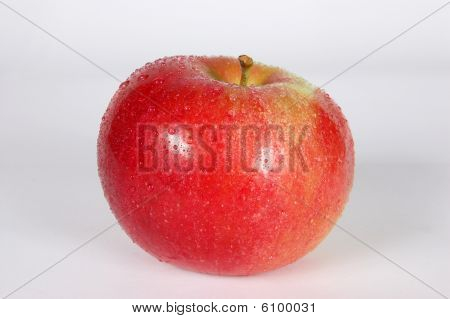 Red apples in droplets