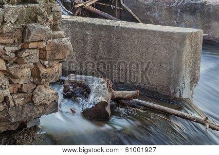 a detail of old river diversion dam - Cache la Poudre River, Fort Collins, Colorado