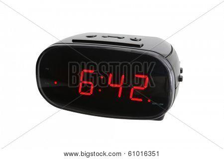 Digital alarm clock on white background