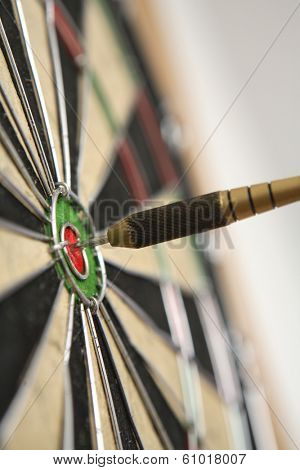 Dart board with dart on bullseye