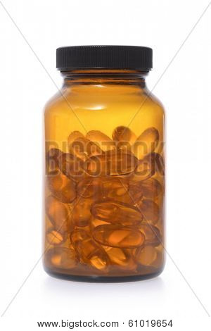 Colored glass pill bottle with vitamin pills on white background
