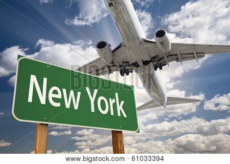 New York Green Road Sign and Airplane Above with Dramatic Blue Sky and Clouds.