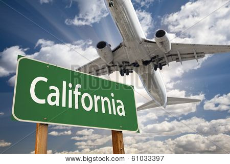 California Green Road Sign and Airplane Above with Dramatic Blue Sky and Clouds.