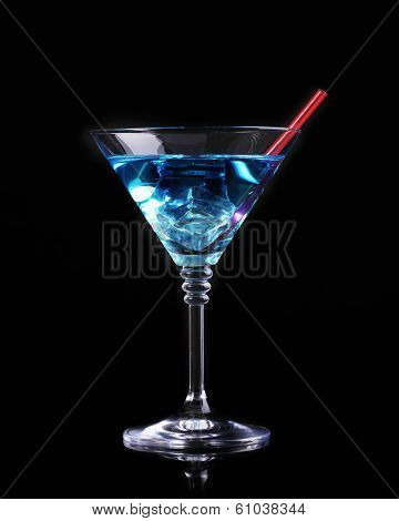 Blue cocktail in martini glass isolated on black