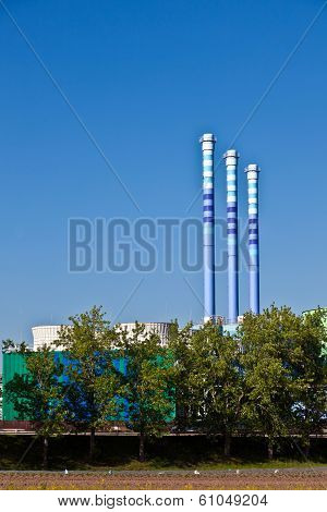 Industry park with silo and chimney under blue sky