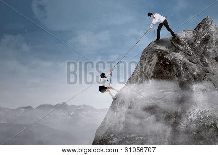 Businessman Helping His Partner