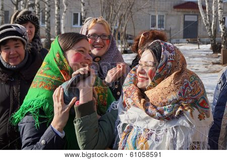 Mstyora,Russia-February 28,2014:Young girls in bandanas raise atheletic projectile