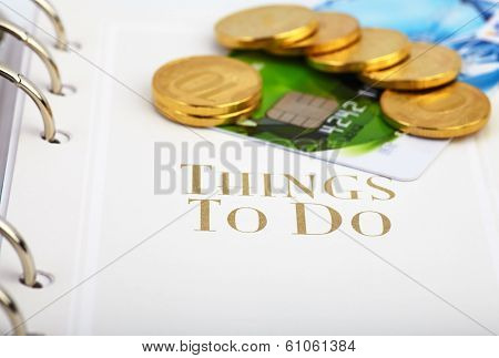 Credit Card, Golden Coins  On The Page Of An Organizer With The Words ''things To Do''. Selective Fo