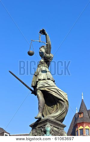 FRANKFURT, GERMANY - JUNE 3, 2012: Statue of Lady Justice in front of the Romer in Frankfurt - Germany