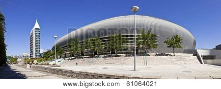Lisbon, Portugal - August 02, 2013: Atlantico Pavilion (Pavilhao Atlantico), currently called MEO Arena, and Sao Rafael Tower in the background  in Park of Nations (Parque das Nacoes)