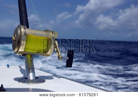 A Bronze Fishing Reel And Rod Setup At Sea
