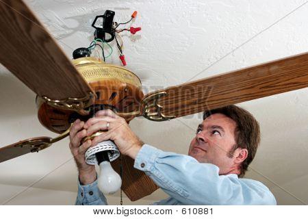 Electrician Removes Ceiling Fan