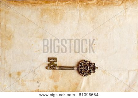 Brass Key And Old Texture