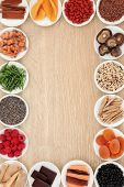 Healthy superfood abstract border over oak wood background poster