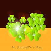 Happy St. Patrick's Day celebrations poster, banner or flyer design with Irish lucky clover leaf on brown and orange background.  poster
