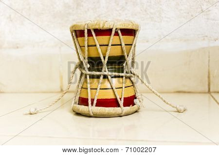 Vertical Small two-headed drum called as Damru used in Hinduism and Tibetan buddism