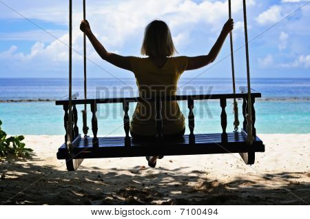 Woman's Silhouette On A Swing