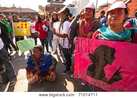 KATHMANDU, NEPAL - NOV 29, 2013: Unidentified participants protest within a campaign to end violence against women (VAW) Held annually since 1991, 16 days from Nov 25 to Dec 10.