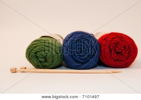 Three Skeins of Yarn and Needles