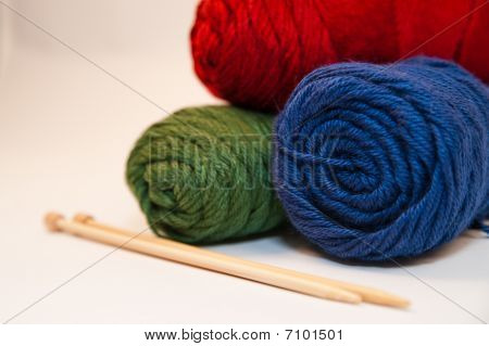 Tri-Color Yarn Skeins and Knitting Needles