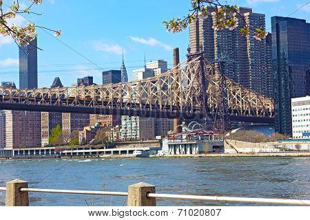 Queensboro Bridge East River and Manhattan buildings.
