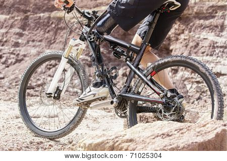 Handicapped Mountain Bike Rider Between Rocks