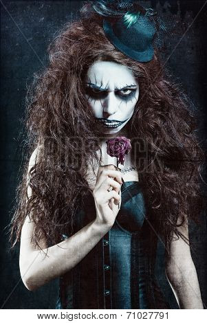 Woman In Image Of Gothic Freak Clown With Withered Flower. Grunge Texture Effect
