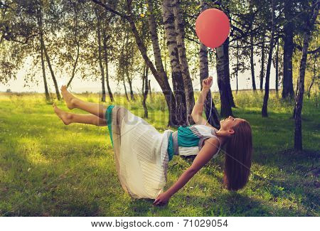 Woman Levitating In The Forest