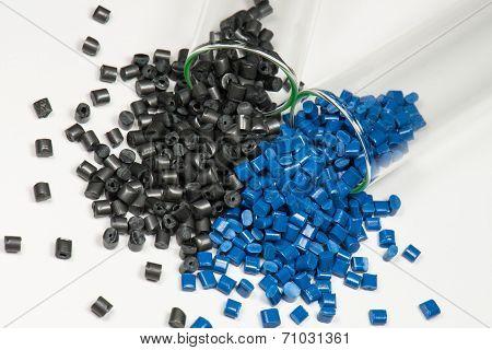 Black And Blue Polymer Pellets In Test Tubes