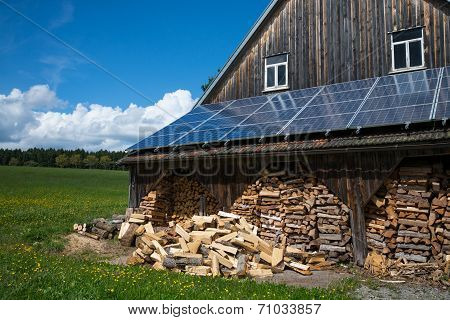 solar power panels and fire wood